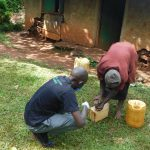 The Water Project: Emulembo Community, Gideon Spring -  Making A Leaky Tin For Gideon Spring