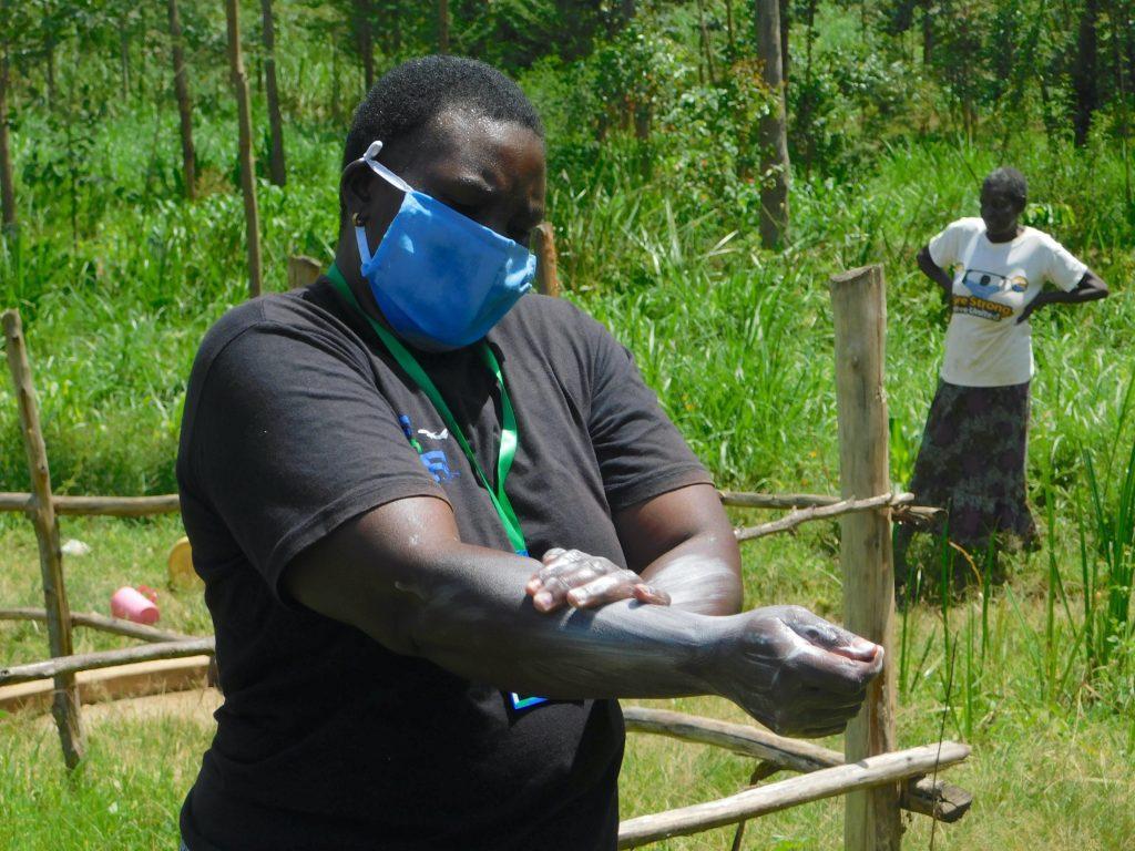 The Water Project : 13-covid19-kenya19183-emmah-demonstrates-handwashing