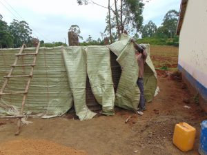 The Water Project:  Extraction Of Sacks From Plastered Wall