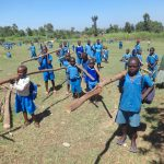 The Water Project: St. Michael Mukongolo Primary School -  Pupils Carry Poles To Insert For Dome Support