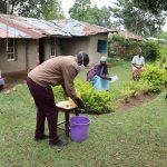 The Water Project: Irungu Community, Irungu Spring -  Demonstration Of Proper Handwashing