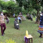 The Water Project: Irungu Community, Irungu Spring -  Trainers Wearing Masks In Action