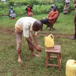The Water Project: Wanzuma Community, Wanzuma Spring -  A Community Member Demonstrates Handwashing At The Training