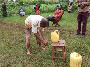The Water Project:  A Community Member Demonstrates Handwashing At The Training