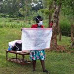 The Water Project: Asimuli Community, John Omusembi Spring -  Use Of Charts At The Training