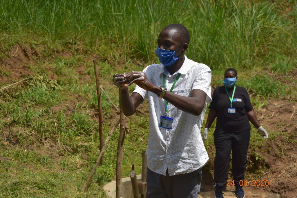 The Water Project : 15-covid19-kenya19177-trainer-protus-demonstrates-handwashing
