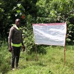 The Water Project: Eluhobe Community, Amadi Spring -  A Community Member Next To The Chart At The Spring