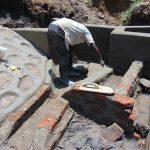 The Water Project: Shikangania Community, Abungana Spring -  Plasterwork