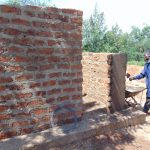 The Water Project: Kapsaoi Primary School -  Latrine Wall Plastering