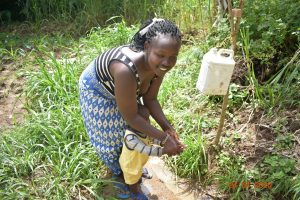 The Water Project:  Helping Her Child Wash Hands