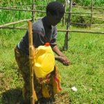 The Water Project: Sichinji Community, Kubai Spring -  Handwashing Demonstration By Community Member