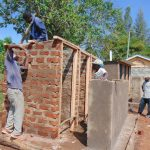 The Water Project: Kapsaoi Primary School -  Latrine Framing And Roofing