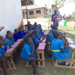 The Water Project: St. Michael Mukongolo Primary School -  Students Brainstorm Good Hygiene Behaviors With Trainer Carolyne