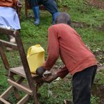 The Water Project: Maganyi Community, Bebei Spring -  An Improvised Handwashing Station With Soap And Water