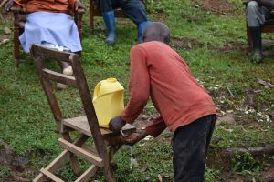 The Water Project:  An Improvised Handwashing Station With Soap And Water