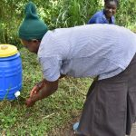 The Water Project: Ingavira Community, Laban Mwanzo Spring -  Handwashing Demonstration
