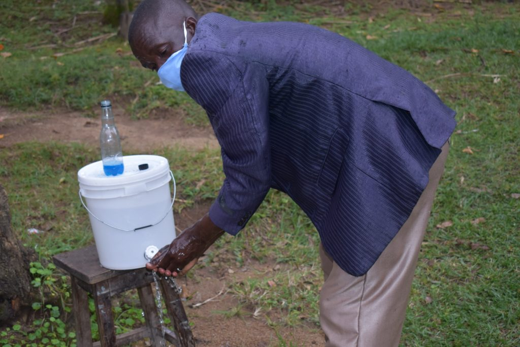 The Water Project : 2-covid19-kenya19093-demonstrating-handwashing