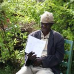 The Water Project: Lutali Community, Lukoye Spring -  An Elderly Man Reading Through The Pamphlet