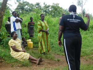 The Water Project:  Community Members Listen To Team Leader Emmah