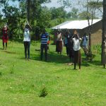 The Water Project: Ataku Community, Ngache Spring -  Staff And Community Joined Hands In A Round Of Applause