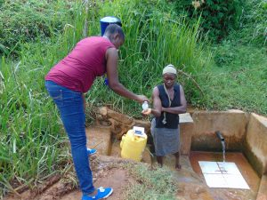 The Water Project:  Sanitizing Community Members Hands Before Training