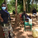 The Water Project: Musango Community, M'muse Spring -  Facilitator With Protective Gear On