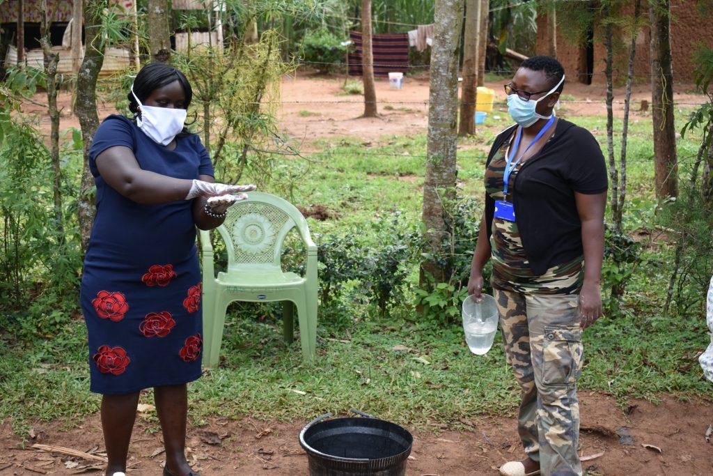 The Water Project : 2-kenya19100-covid19-handwashing-demonstration-by-team-leader-catherine-chepkemoi-2