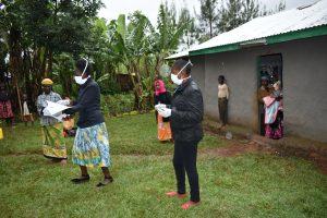 The Water Project:  Facilitators With Protective Gear Conducting Training