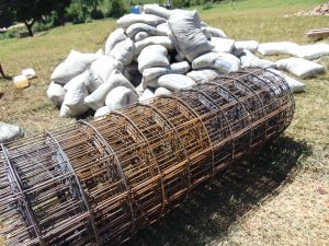 The Water Project:  Bags Of Cement Mix And Wire Ready For Use