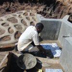The Water Project: Shikangania Community, Abungana Spring -  Tile Setting