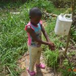 The Water Project: Emukoyani Community, Ombalasi Spring -  Demonstrating Handwashing