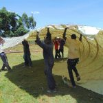 The Water Project: Jinjini Friends Primary School -  Carrying Woven Dome Skeleton To The Tank