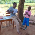 The Water Project: Kapsaoi Primary School -  Trainer Samuel Holds Visual Aids Used At Training
