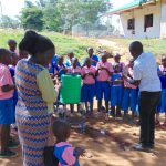 The Water Project: Kapsaoi Primary School -  Facilitator Victor Demonstrates Ten Steps Of Handwashing