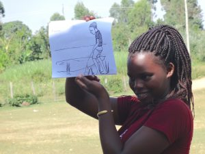 The Water Project:  Carolyne Leads Discussion On Open Defecation And Urination Using Diagram