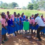 The Water Project: Kapsaoi Primary School -  Facilitator Victor Demonstrates Handwashing