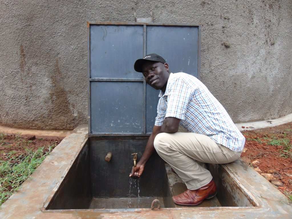 The Water Project : 25-kenya20124-the-deputy-head-teacher-at-the-water-point