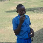 The Water Project: St. Michael Mukongolo Primary School -  A Student Demonstrates Toothbrushing