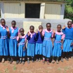 The Water Project: Kapsaoi Primary School -  Pupils And Staff Posing At New Girls Latrines