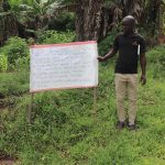 The Water Project: Ematetie Community, Weku Spring -  At The Spring Next To The Reminder Chart