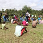 The Water Project: Elutali Community, Obati Spring -  Issuing Handouts To Participants
