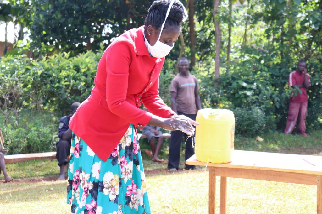 The Water Project : 3-covid19-kenya4710-trainer-shigali-showed-the-group-the-proper-method