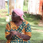 The Water Project: Lutali Community, Lukoye Spring -  An Elderly Woman Practices Handwashing
