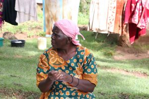 The Water Project:  An Elderly Woman Practices Handwashing