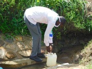 The Water Project:  Trainer Protus Preparing The Leaky Tin