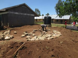 The Water Project:  Rocks Laid On Tank Foundation