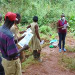 The Water Project: Shitaho Community, Mwikholo Spring -  Trainers Explain Informational Pamphlets