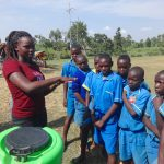 The Water Project: St. Michael Mukongolo Primary School -  Carolyne Demonstrates Handwashing