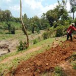 The Water Project: Shikangania Community, Abungana Spring -  Digging Cut Off Drainage Above Spring
