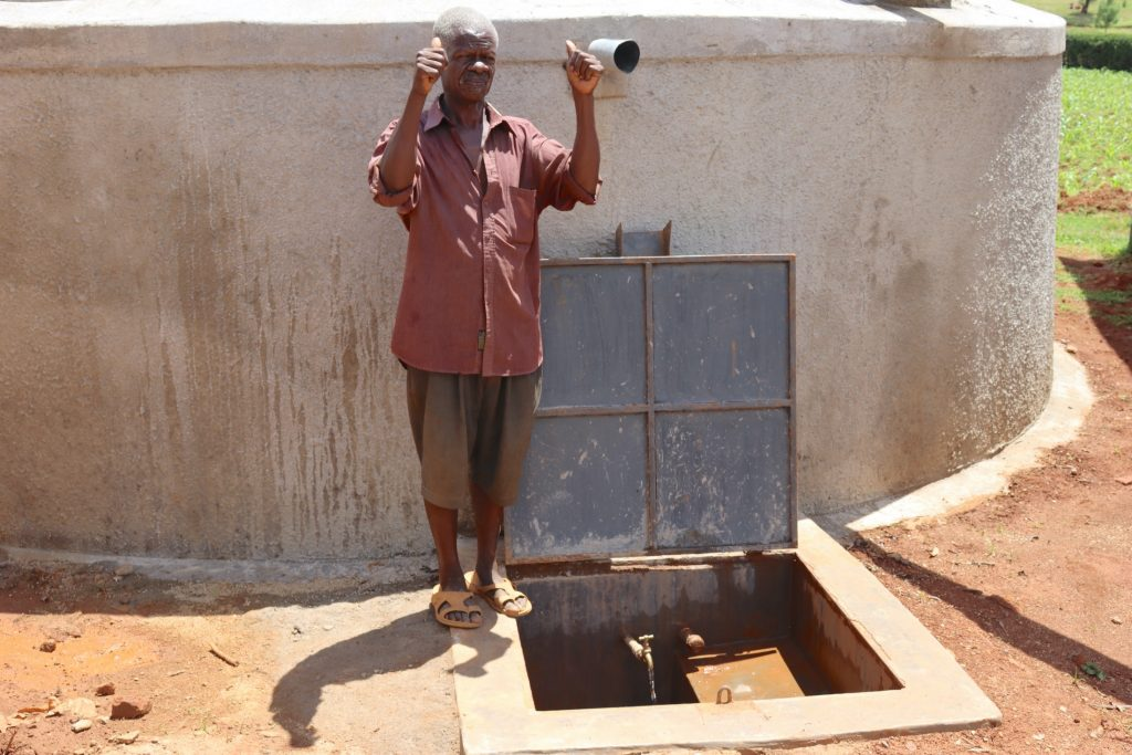 The Water Project : 33-kenya20126-the-security-guard-gives-thumbs-up-for-water-flowing